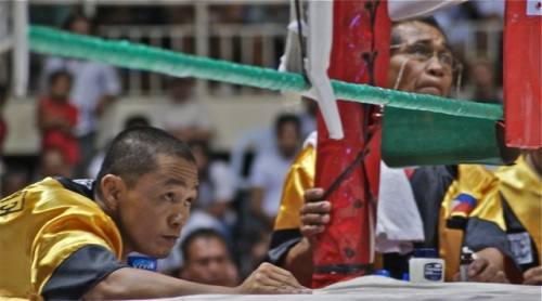 """Tension etched on the faces of the Filipino boxer's camp"" retirednoway"