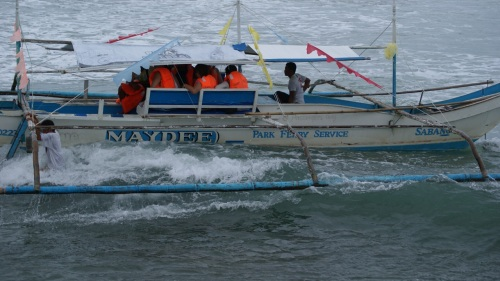 """One of Sabang's ferry boats that take travelers to the cave"" retirednoway"