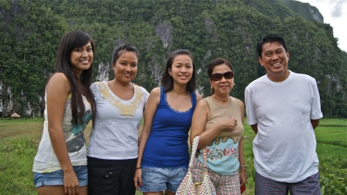 """Visitors posing in front of one of the karst formations in central Palawan"" retirednoway"