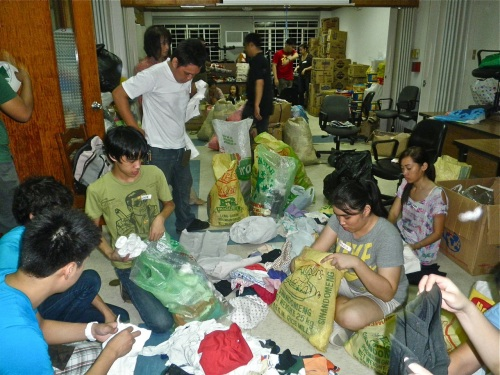 """Volunteers sorting, packing, and labeling donated material"" retirednoway"