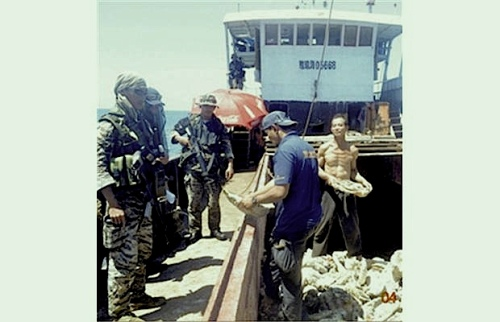 """Members of the Philippine army inspect a load of giant clams Tuesday on one of eight Chinese fishing boats spotted in the Scarborough Shoal, a small group of rocky formations in the South China Sea whose sovereignty is contested by the Philippines and China. Photograph by: Reuters, Vancouver Sun."" retirednoway"