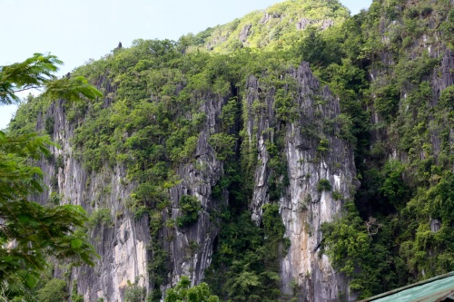 """The cliff behind the Municipal Hall. Note the two large caves (dark areas) on the wall's face."" retirednoway"