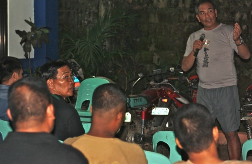 """Cooper presenting in front of police officers at the El Nido Police Station"""