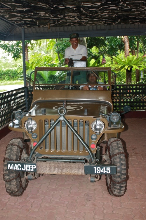 """""""Surrounding the jeep is a fence made of Marsden steel plates. Great stuff! I remember seeing those steel plates in Quezon City when I was growing up. (http://en.wikipedia.org/wiki/Marsden_Matting)"""" retirednoway"""
