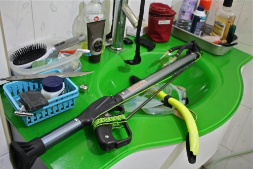 """Drying the speargun on my garish-looking bathroom sink. The yellow cord that tethers the spear to the gun is two meters long. The disassembled tang of the diving knife is visible on the left."" retirednoway"