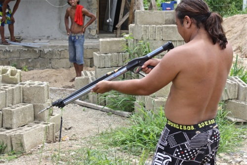 """""""Bruno testing the gun. I don't know how to explain his attire except to say that men, especially those working under the heat of the sun, like to work topless."""" retirednoway"""