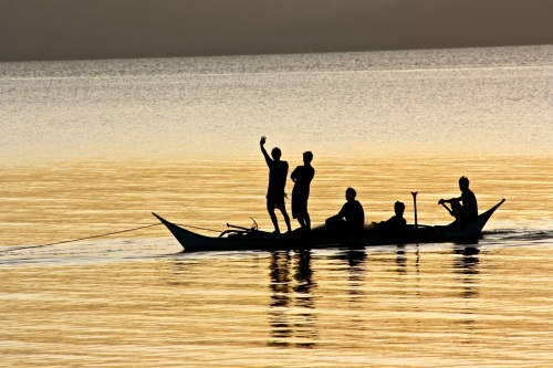 "retirednoway, ""Friendly Romblonians on a banca being towed at dusk"""