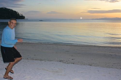 """retirednoway, """"Cooper horsing around on Tiamban Beach at sunset."""""""