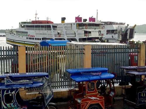 "retirednoway, ""Docked at the port of Romblon are Montenegro Lines' mv Maria Erlinda and 2Go Travel's mv St. Augustine of Hippo."""